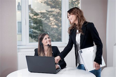 superior - Portrait of two young businesswomen Stock Photo - Premium Royalty-Free, Code: 6121-07810209