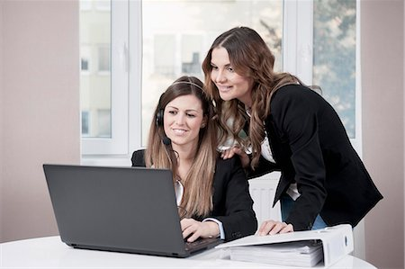 superior - Portrait of two young businesswomen Stock Photo - Premium Royalty-Free, Code: 6121-07810210