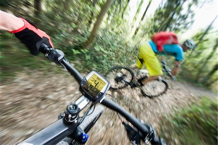 Two Mountainbikers racing down mountain track Stock Photo - Premium Royalty-Free, Code: 6121-07810346