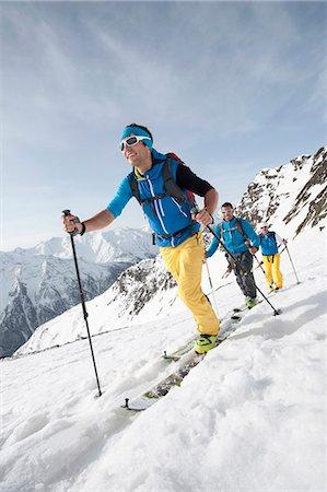 Three men skiing winter Alps cross-country Stock Photo - Premium Royalty-Free, Code: 6121-07810352