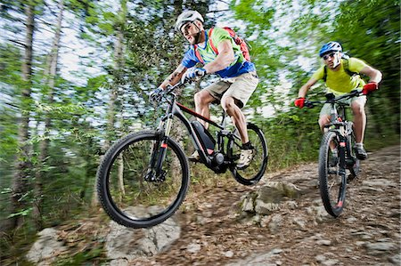 Two Mountainbikers stunt racing forest track Stock Photo - Premium Royalty-Free, Code: 6121-07810365