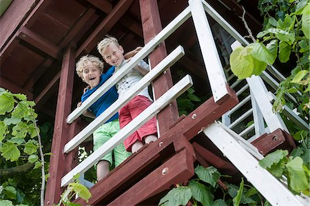 Young boys tree-house balcony ladder happy Stock Photo - Premium Royalty-Free, Code: 6121-07810388