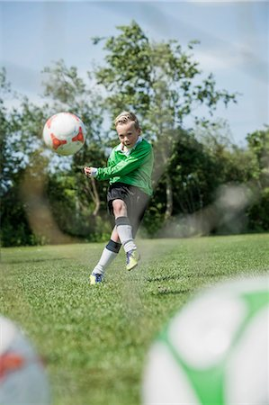 Young junior boy soccer player practicing penalty Stock Photo - Premium Royalty-Free, Code: 6121-07810307
