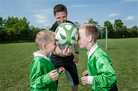 Football coach training young players Stock Photo - Premium Royalty-Free, Code: 6121-07810315