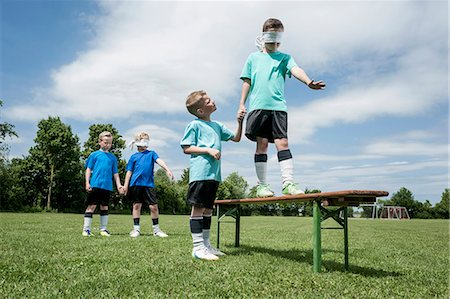 Young football players learning trust courage Stock Photo - Premium Royalty-Free, Code: 6121-07810321