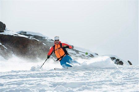 Man skiing downhill powder snow Alps Stock Photo - Premium Royalty-Free, Code: 6121-07810328