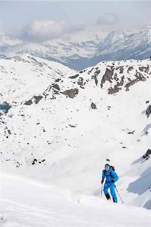 Man climbing mountain Alps snow winter Stock Photo - Premium Royalty-Free, Code: 6121-07810334