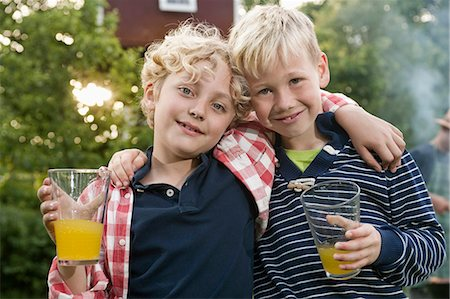 Portrait two young boys friends smiling blond Stock Photo - Premium Royalty-Free, Code: 6121-07810447