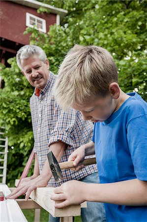 Grandfather grandson working together wood Stock Photo - Premium Royalty-Free, Code: 6121-07810411