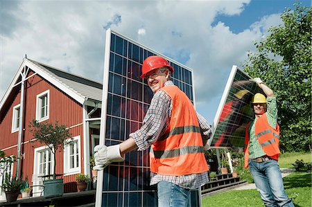 solar power - Two workmen installing solar panel house Stock Photo - Premium Royalty-Free, Code: 6121-07810421