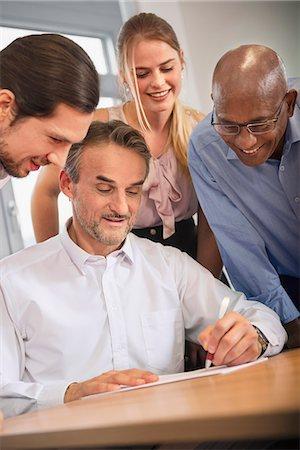 Team woman men office Brainstorming planning Stock Photo - Premium Royalty-Free, Code: 6121-07970052