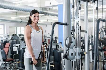 Attractive young woman portrait fitness studio Stock Photo - Premium Royalty-Free, Code: 6121-07970178