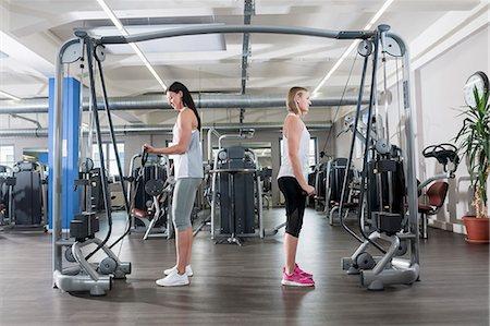 Two young women fitness studio sport practising Stock Photo - Premium Royalty-Free, Code: 6121-07970180