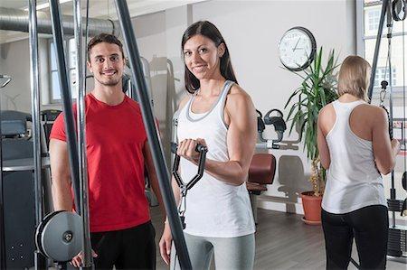 Fitness studio man two women sport healthy fit Stock Photo - Premium Royalty-Free, Code: 6121-07970181