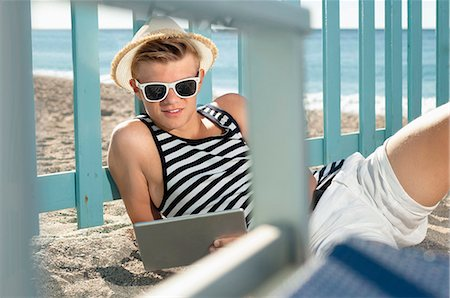 Portrait teenager beach holiday tablet computer Stock Photo - Premium Royalty-Free, Code: 6121-07970185