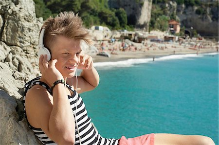 Teenager holiday headphones listening music Stock Photo - Premium Royalty-Free, Code: 6121-07970194