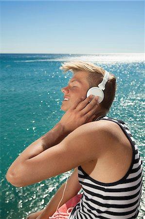 Ocean sunshine portrait teenager headphones music Stock Photo - Premium Royalty-Free, Code: 6121-07970196