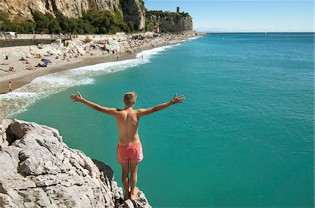 shirtless teen boy - Teenager boy cliff holiday ocean waiting adventure Stock Photo - Premium Royalty-Free, Code: 6121-07970198