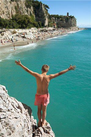shirtless teen boy - Boy cliff diving holiday risk holiday waiting Stock Photo - Premium Royalty-Free, Code: 6121-07970199