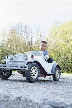 Young kid boy driving model vintage car Stock Photo - Premium Royalty-Free, Code: 6121-07970122