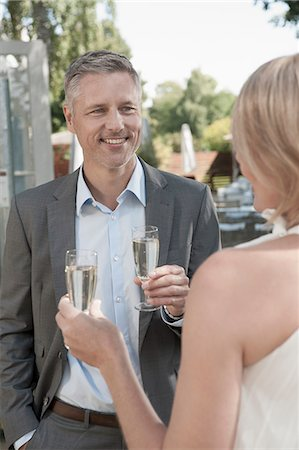 Man woman party wedding drinking champagne Stock Photo - Premium Royalty-Free, Code: 6121-07970242