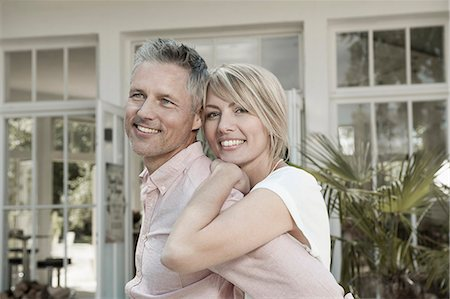 Couple married hugging garden portrait smiling Stock Photo - Premium Royalty-Free, Code: 6121-07970247