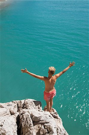 shirtless teen boy - Boy cliff diving holiday ocean sunshine summer Stock Photo - Premium Royalty-Free, Code: 6121-07970200