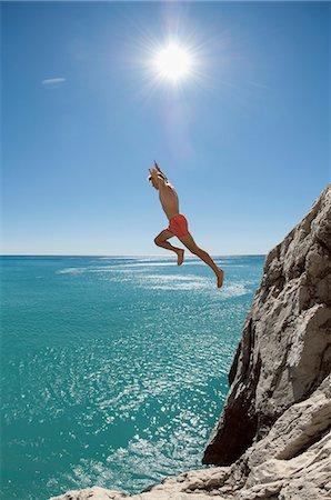 shirtless teen boy - Teenager risk danger ocean holiday jump dive water Stock Photo - Premium Royalty-Free, Code: 6121-07970202