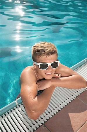 shirtless teen boy - Boy swimming pool sunglasses holiday relaxing Stock Photo - Premium Royalty-Free, Code: 6121-07970215
