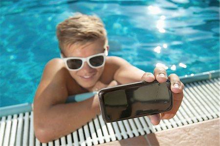 shirtless teen boy - Close-up teenager boy swimming pool self-portrait Stock Photo - Premium Royalty-Free, Code: 6121-07970218