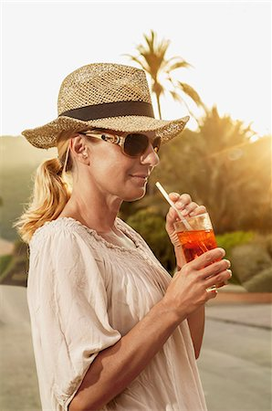 Portrait chic mature blond woman holiday cocktail Stock Photo - Premium Royalty-Free, Code: 6121-07970221