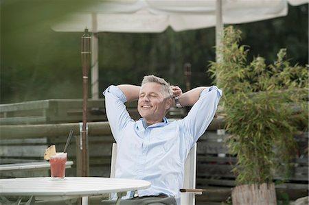 european cafe bar - Portrait smiling relaxing man garden eyes closed Stock Photo - Premium Royalty-Free, Code: 6121-07970232