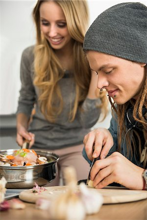Couple preparing food in the kitchen, Munich, Bavaria, Germany Stock Photo - Premium Royalty-Free, Code: 6121-07992575