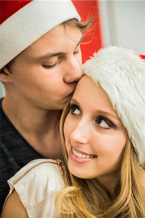 Young couple romancing on Christmas eve, Munich, Bavaria, Germany Stock Photo - Premium Royalty-Free, Code: 6121-07992583