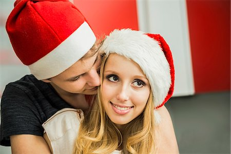 Young couple romancing on Christmas eve, Munich, Bavaria, Germany Stock Photo - Premium Royalty-Free, Code: 6121-07992584