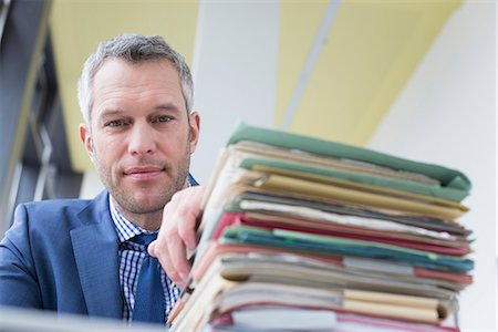 piles of work - Businessman working in office, Leipzig, Saxony, Germany Stock Photo - Premium Royalty-Free, Code: 6121-08106626
