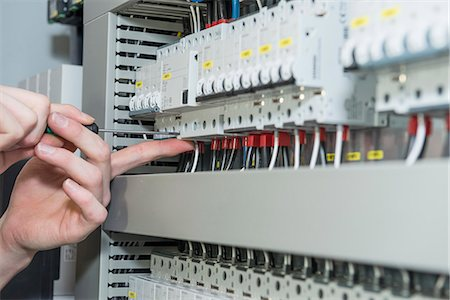 electrician fixing fuse box stock photos page 1 masterfile electrician fixing fuse box close up of electrician screwing cable in distribution fusebox