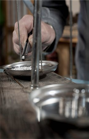 rich lifestyle - Senior male goldsmith checking silvers on scale at workshop, Bavaria, Germany Stock Photo - Premium Royalty-Free, Code: 6121-08106942