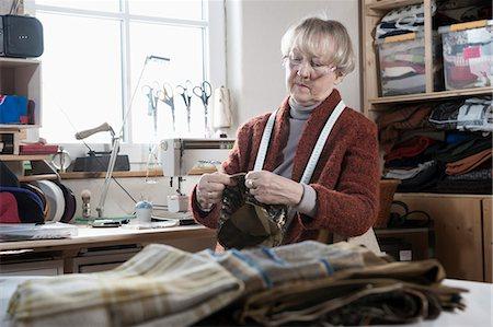 designer - Senior female fashion designer stitching cap in workshop, Bavaria, Germany Stock Photo - Premium Royalty-Free, Code: 6121-08106948