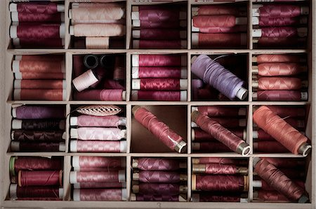 Reels of sewing threads in box, Bavaria, Germany Stock Photo - Premium Royalty-Free, Code: 6121-08106975