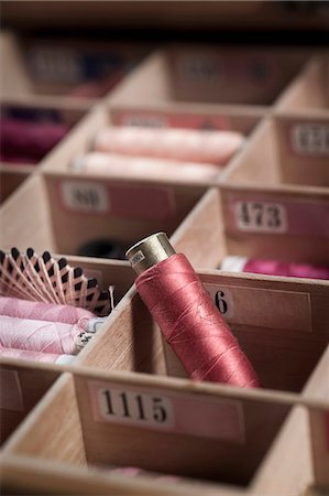 Reels of sewing threads in box, Bavaria, Germany Stock Photo - Premium Royalty-Free, Code: 6121-08106976