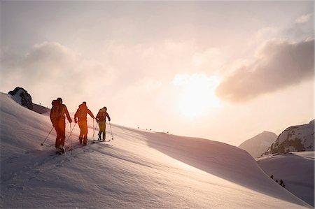 extreme terrain - Ski mountaineers climbing on snowy mountain, Tyrol, Austria Stock Photo - Premium Royalty-Free, Code: 6121-08106992