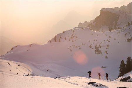 extreme terrain - Ski mountaineers climbing on snowy mountain, Tyrol, Austria Stock Photo - Premium Royalty-Free, Code: 6121-08106994