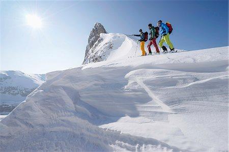 extreme terrain - Ski mountaineers climbing on snowy peak, Tyrol, Austria Stock Photo - Premium Royalty-Free, Code: 6121-08106998