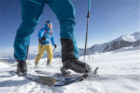extreme terrain - Ski mountaineers climbing on snowy mountain in snow storm, Zell Am See, Austria Stock Photo - Premium Royalty-Free, Code: 6121-08107003