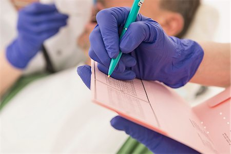 dentistry - Dental assistant writing on index card, Munich, Bavaria, Germany Stock Photo - Premium Royalty-Free, Code: 6121-08228455