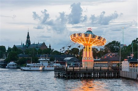 stockholm - Tourists on carousel swings, Nordiska Museet, Grona Lund, Djurgarden, Stockholm, Sweden Stock Photo - Premium Royalty-Free, Code: 6121-08228782