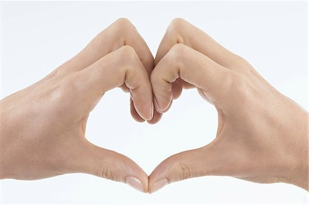 Close-up of woman's hands making heart shape, Bavaria, Germany Stock Photo - Premium Royalty-Free, Code: 6121-08228730