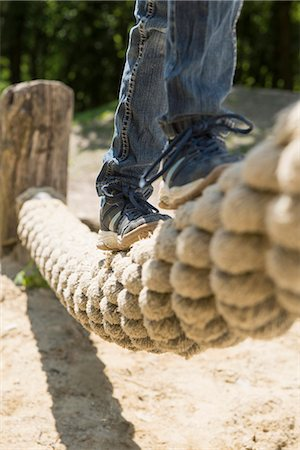 Girl balancing on rope in playground, Munich, Bavaria, Germany Stock Photo - Premium Royalty-Free, Code: 6121-08228847