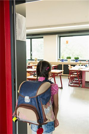 european (places and things) - Rear view of a schoolgirl entering in classroom, Munich, Bavaria, Germany Stock Photo - Premium Royalty-Free, Code: 6121-08228944